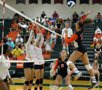 Sophomore outside hitter Lucia Pampana (11) spikes the ball during the Canes' season opener against Florida A&M Friday evening in the James L. Knight Sports Complex. Joshua White // Contributing Photographer