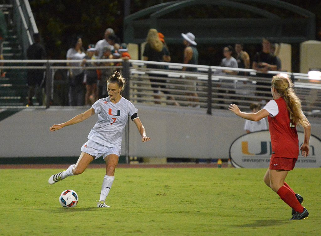 Senior midfielder Gianna Dal Pozzo (7) handles the ball during the Canes' regular season home opener against Ohio State Friday night at Cobb Stadium. Joshua White // Contributing Photographer