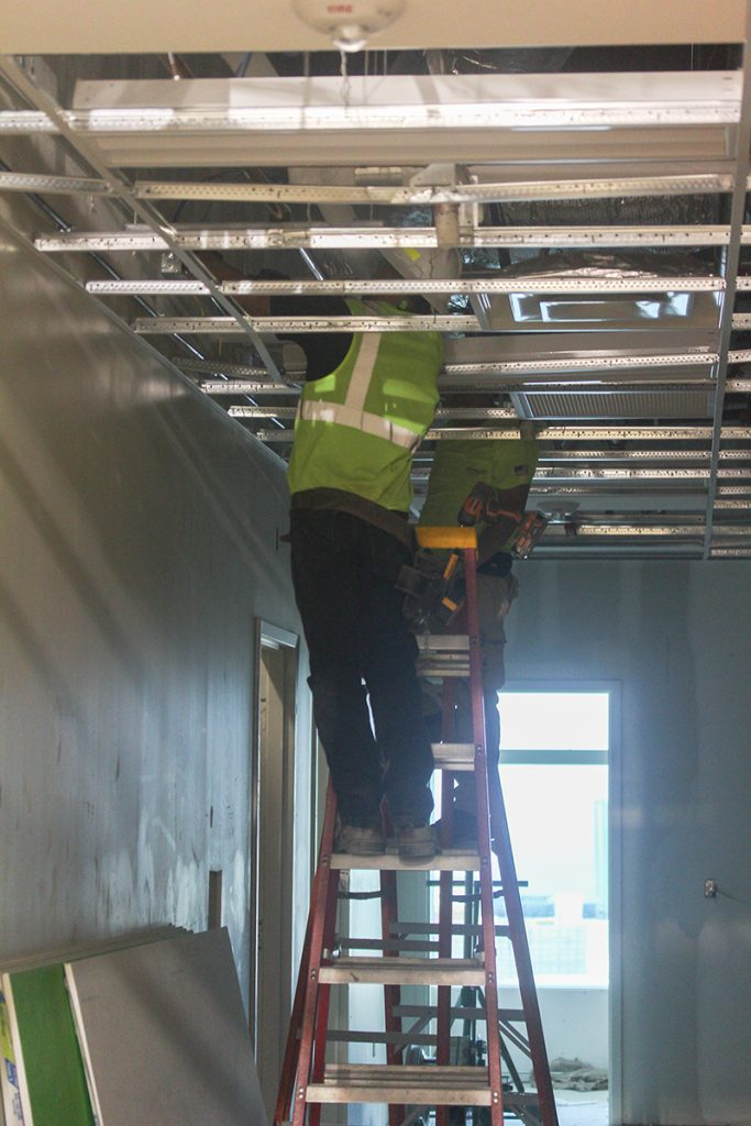 Construction workers wire electrical cables throughout the Lennar Foundation Medical Center. Victoria McKaba // Photo Editor