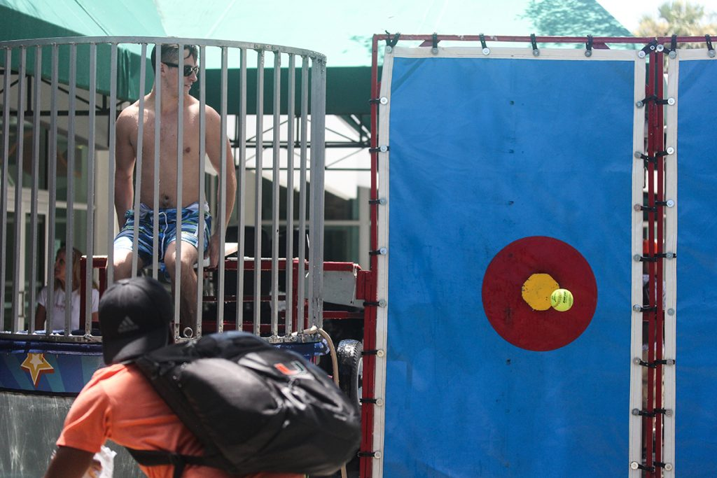 This week's photo of the week comes from staff photographer Erum Kidwai and features senior Connor Masterson sitting in a dunk tank at the The LaunchPad's Launch Day Tuesday afternoon at the Lakeside Patio.