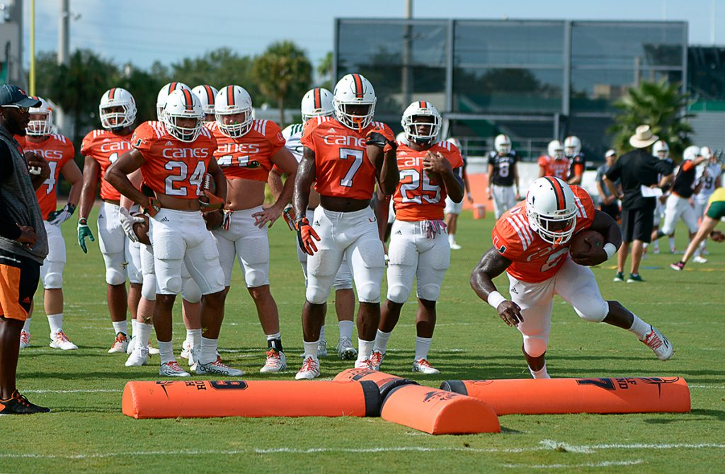 The football team runs drills at Greentree Practice Fields Friday morning. Joshua White // Contributing Photographer