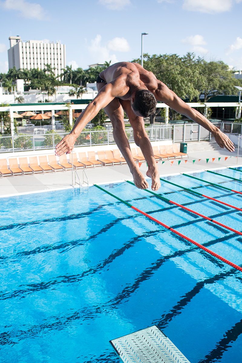 alumnus sam dorman class of 2015 dives off a springboard during practice at the - Olympic Swimming Pool 2015