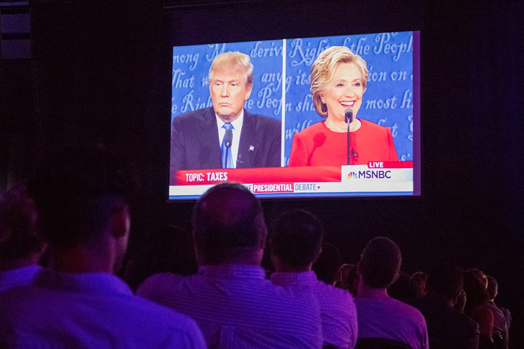 Students and community members gather at the Convocation Center Fieldhouse Monday evening to watch the first of the Presidential Debates. Samuel Montero // Contributing Photographer