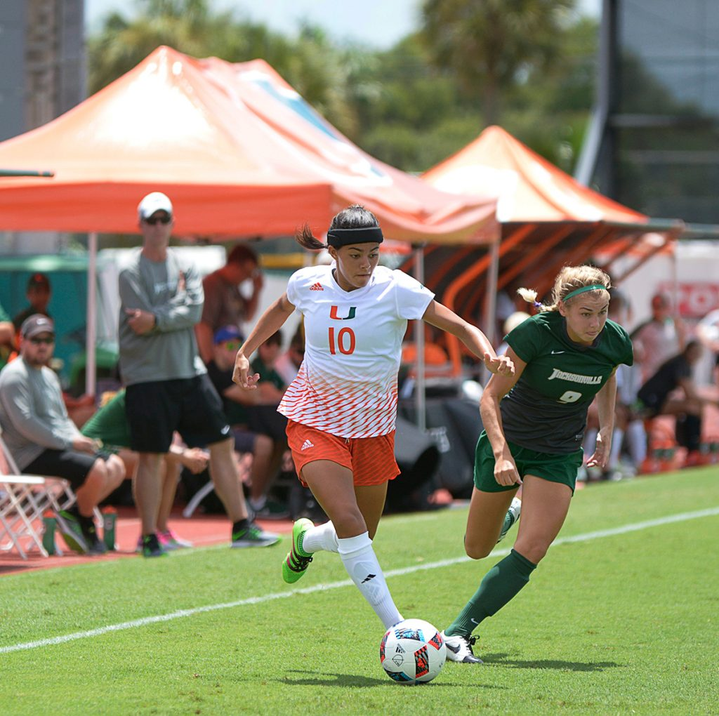 Freshman forward Kristina Fisher (10) strikes the ball during the women's soccer win over Jacksonville University in August. Joshua White // Contributing Photographer