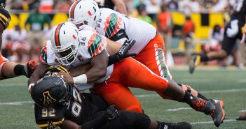 The UM offensive line continues to open up running lanes for teammates, as seen here during the September game against Appalachian State in Boone, N.C. Photo Courtesy Dallas Linger
