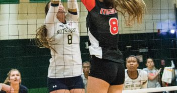 Sophomore outside hitter Anna Haak (8) blocks opponent during the match against Notre Dame this past weekend in the Knight Sports Complex. Ben Spiro // Contributing Photographer