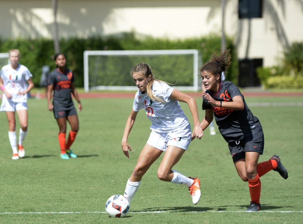 Senior forward Gracie Lachowecki (17) breaks away from a Virginia Tech player during the Canes' 2-1 overtime win to clinch an ACC tournament berth at Cobb Stadium Sunday afternoon. Josh White // Staff Photographer