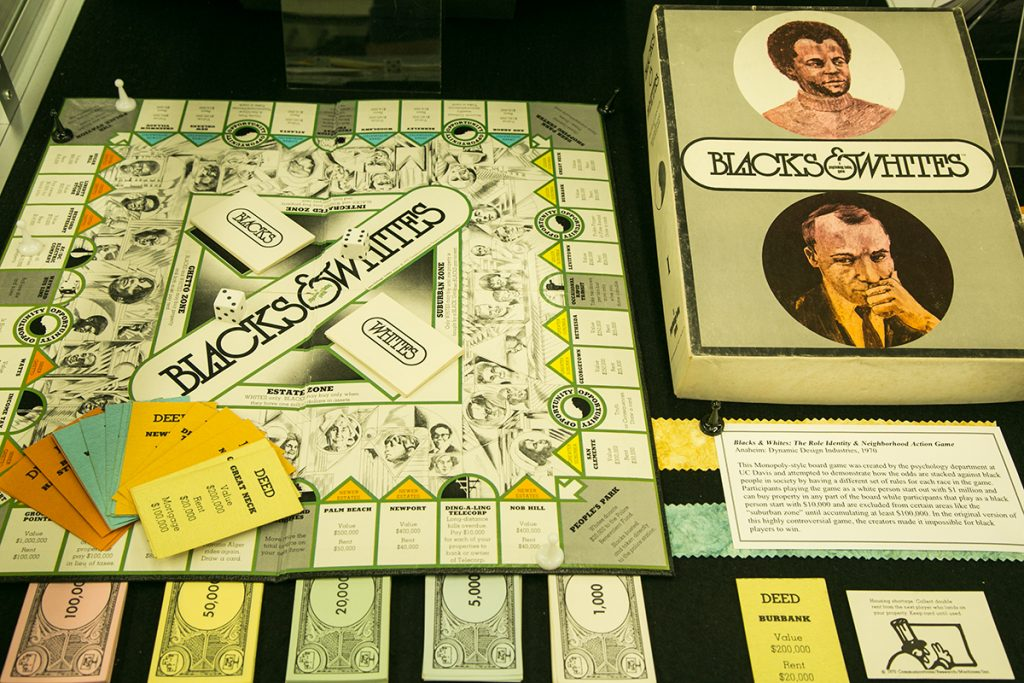 """Blacks & Whites,"" a socially-conscious game which reflected the signs of the times and meant to effect change, is on display in Richter Library's Games Exhibit as part of Special Collections. Evelyn Choi // Staff Photographer"