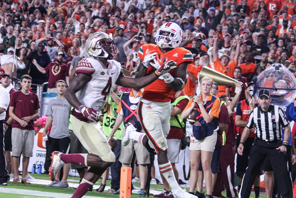 Senior wide receiver Stacy Coley (3) catches a touchdown on fourth down late in the fourth quarter Saturday night at Hard Rock Stadium. Victoria McKaba // Photo Editor