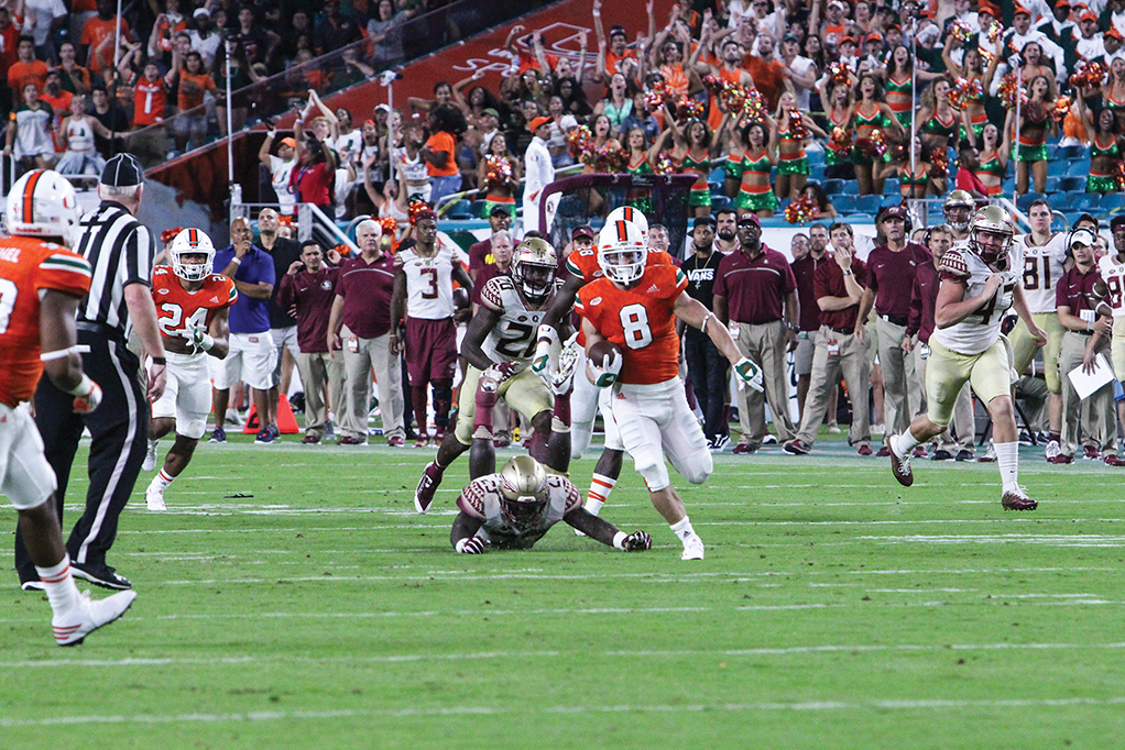 Junior wide receiver Braxton Berrios (8) breaks free on the kick return which set up the Hurricanes for a touchdown late in the fourth quarter during the 20-19 loss to FSU Saturday at Hard Rock Stadium. Hallee Meltzer // Photo Editor
