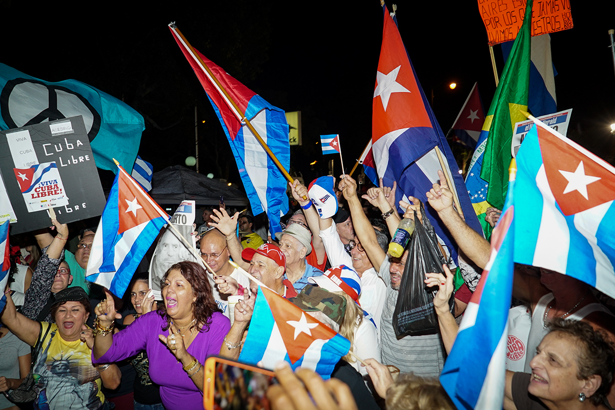 Crowds fly flags high at Wednesday's celebrations in Little Havana. Hunter Crenian // Staff Photographer