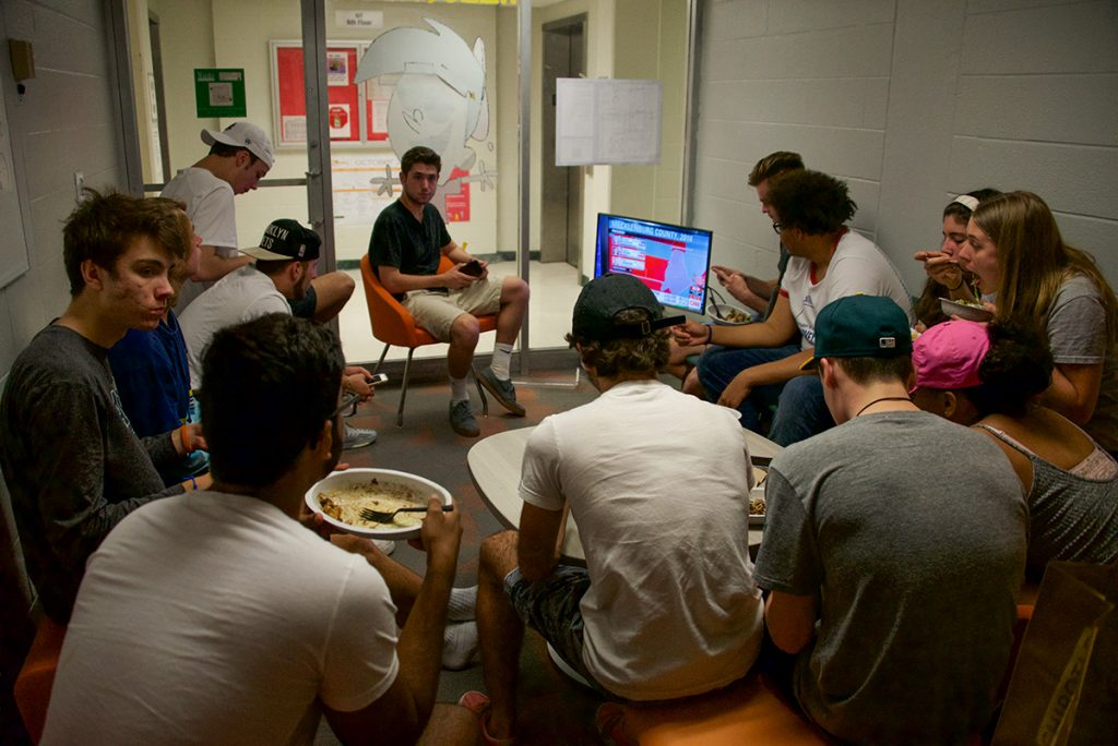 Freshman students watch the election reports Tuesday night in Hecht Residential College. Ben Spiro // Staff Photographer