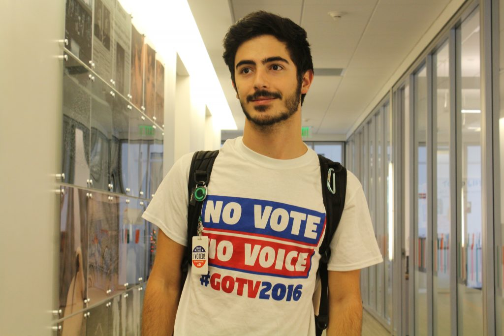 Junior Joe Reda, who voted this morning at St. Augustine Church, wears the shirt he designed for University of Miami Division of Student Affairs and Get Out the Vote. // Jackie Yang, Managing Editor.