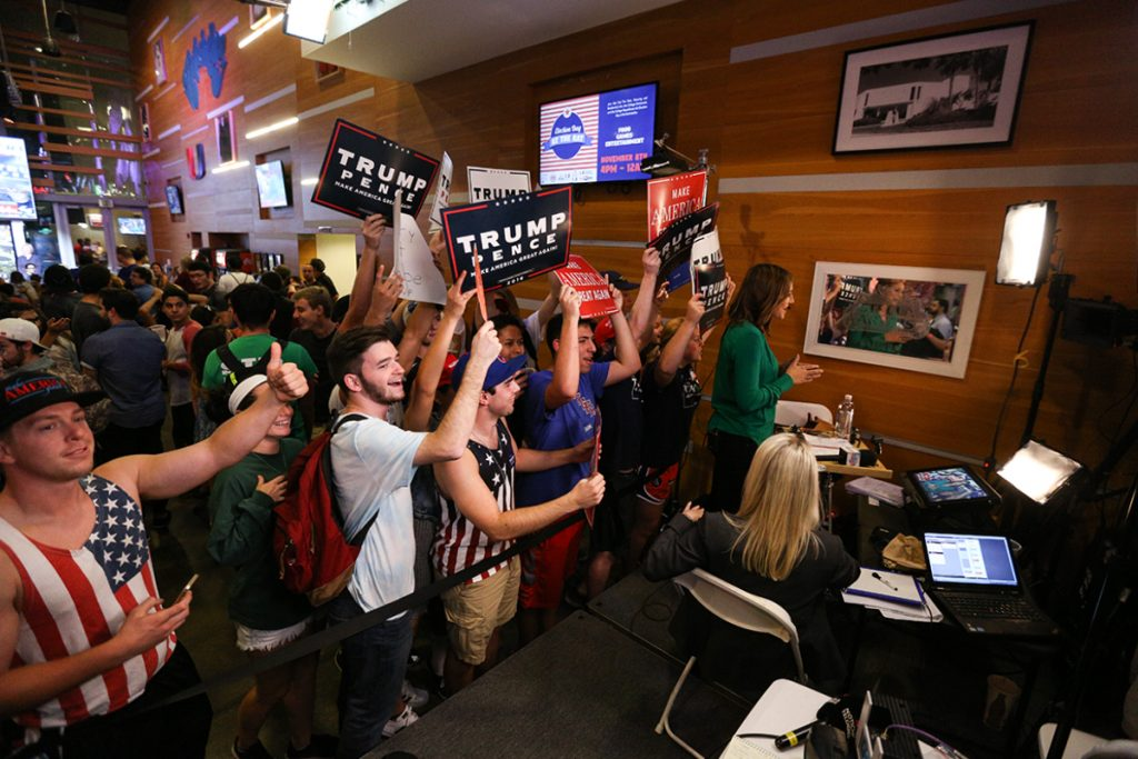 Republican and Democratic students gather behind ABC National's television broadcast Tuesday night at the Rathskeller. Nick Gangemi // Contributing Photographer