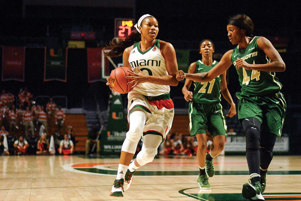 Junior forward Keyanna Harris (0) passes a Charlotte defender during the Canes' 80-46 win in November. Joshua White // Staff Photographer
