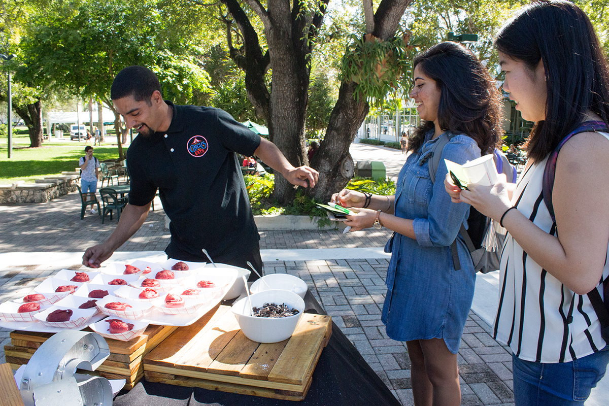 Students receive fried oreos from the Hurricane Productions Pop Up event on the Rock Tuesday afternoon. Shreya Chidarala // Staff Photographer