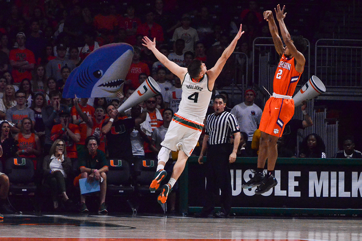 Freshman guard Dejan Vasiljevic (4) jumps to block a shot Saturday night in the Watsco center during the Hurricanes' 71-65 win over Clemson. Matt Bernanke // Contributing Photographer