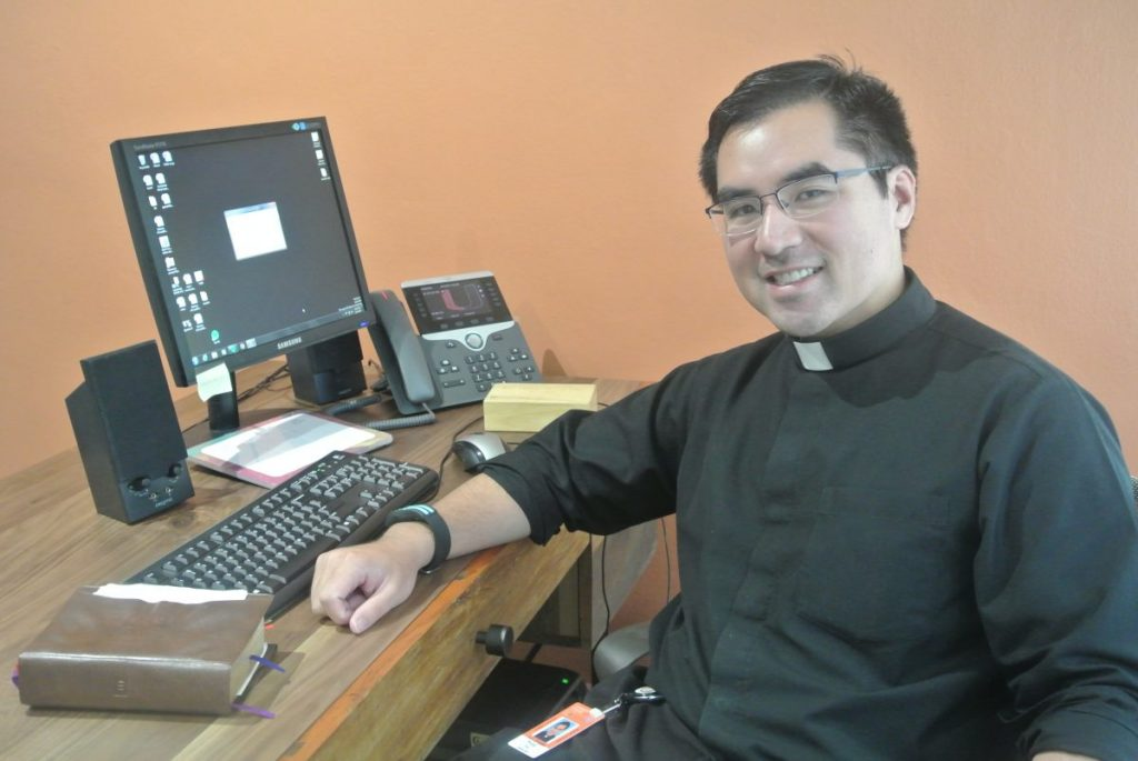 "Father Phillip Tran becomes first full-time priest in UM's history, hopes to make students see ""God in a different way"""