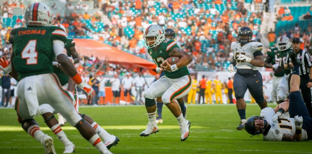 Malik Rosier runs past defender
