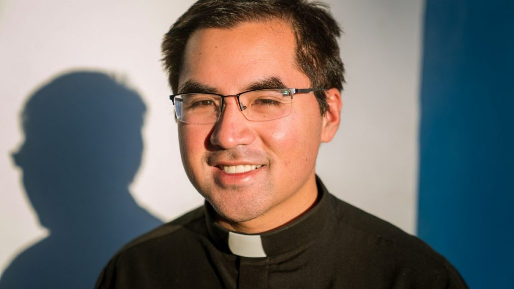 UM's first full-time Catholic priest uses unexpected trials to bond with students