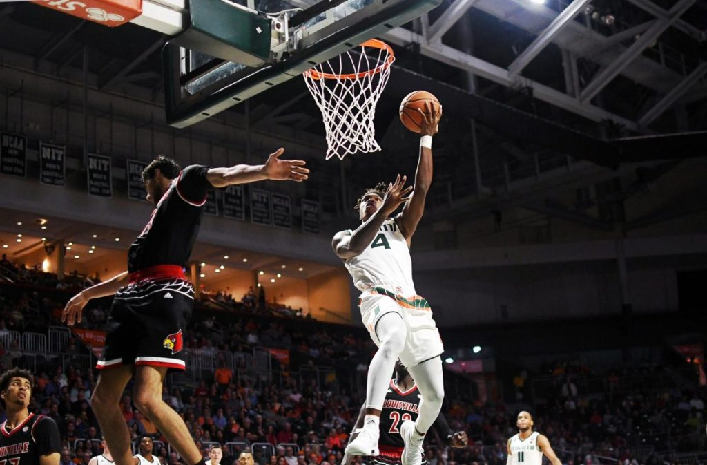 Lonnie Walker's 25 points leads Hurricanes to overtime victory over Cardinals