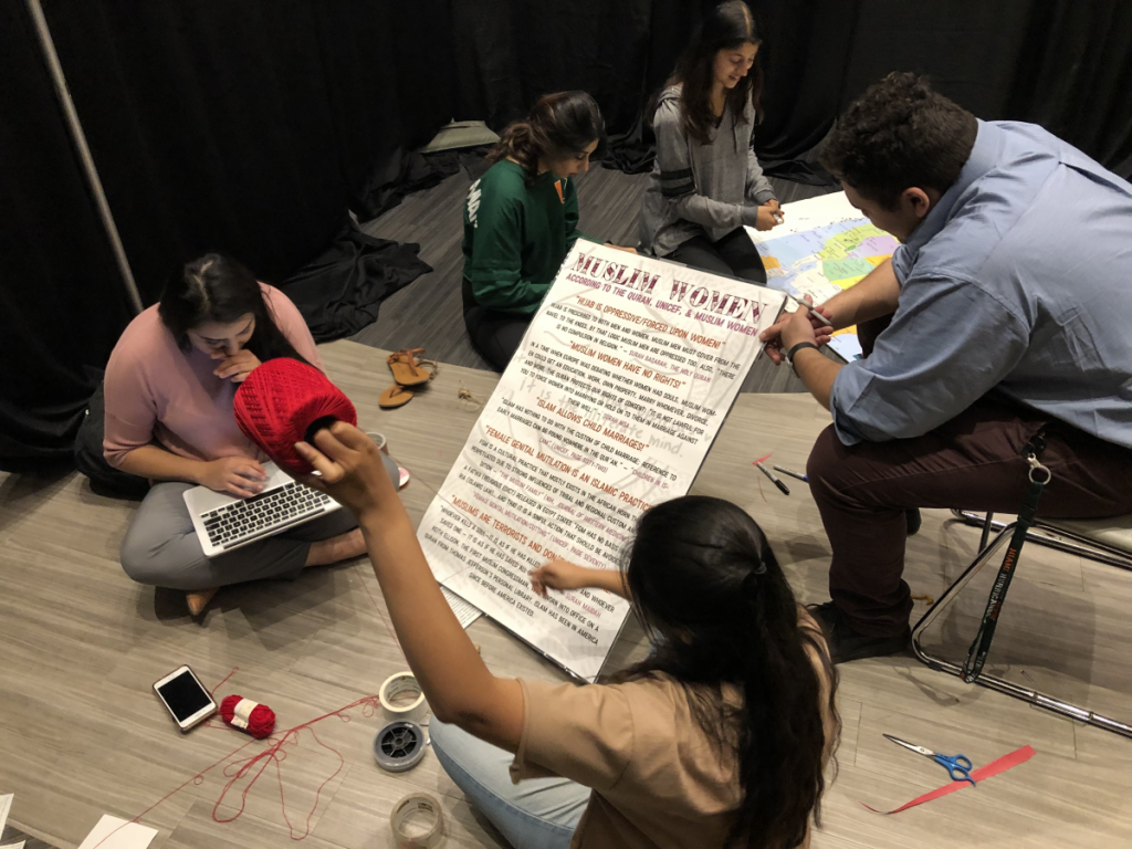 Students begin work on the Tunnel of Oppression, which will take place Jan. 22-24 in the Shalala Student Center Ballrooms. Photo credit: Reese Pitts