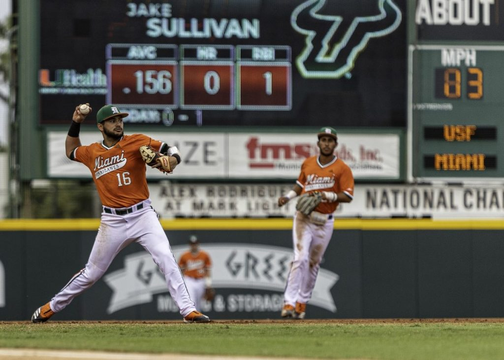Gil (16) attempts to make a play in the infield during Miami's 7-5 win over USF Wednesday night.