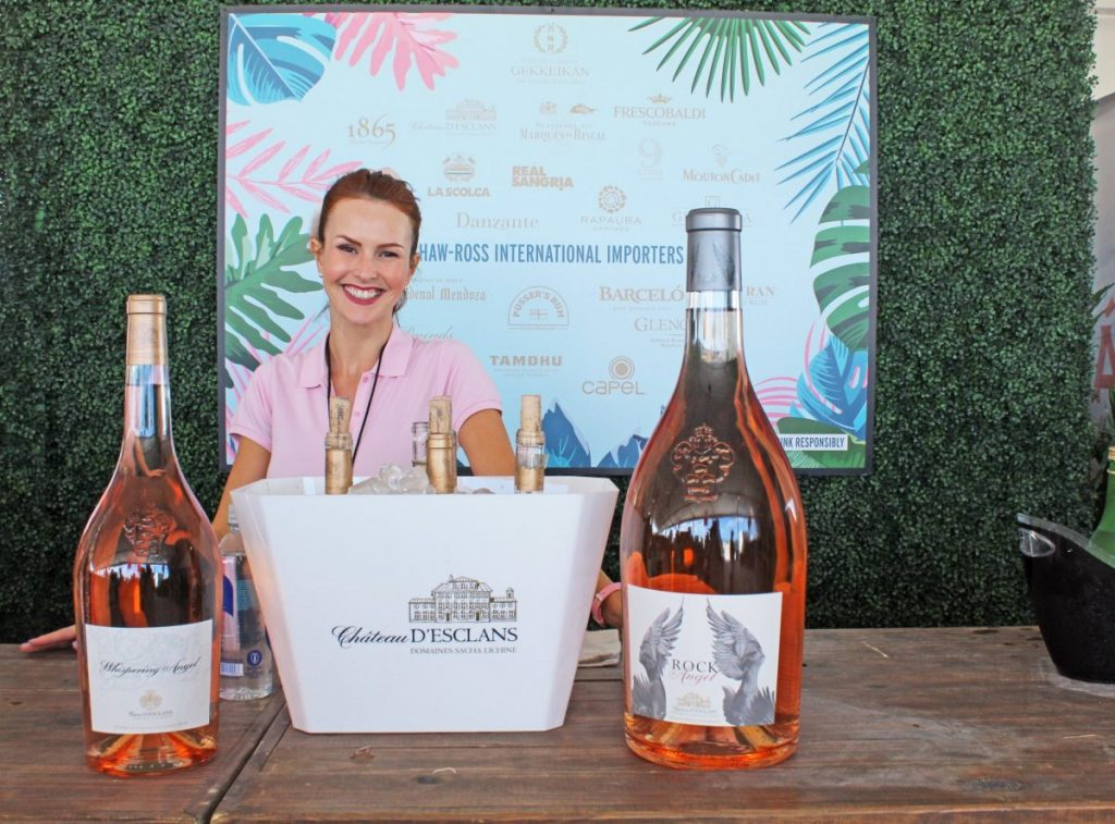 A representative from Shaw-Ross International Importers– leading importer of wine and spirits– offers samples of various Rosé wines at the 2020 South Beach Wine & Food Festival's Goya Grand Tasting Village.