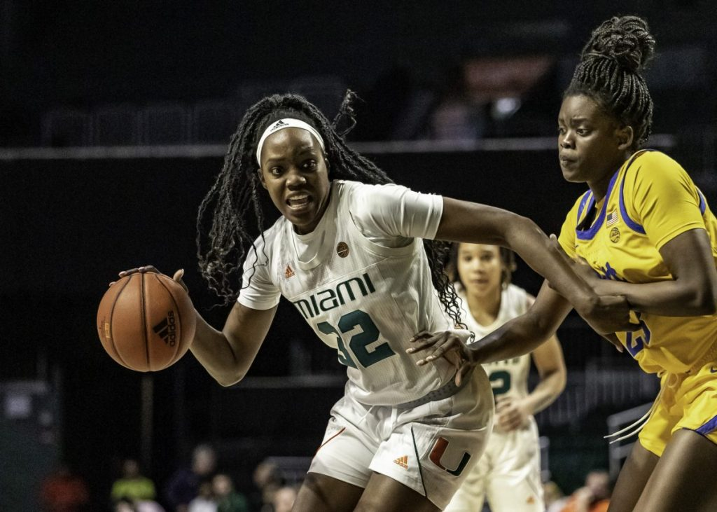 Senior Beatrice Mompremier drives the ball to the basket in Miami's win over Pitt on Sunday, March 1. Mompremier finished the game with 13 points and secured her 1,000th rebound as a Miami Hurricane.