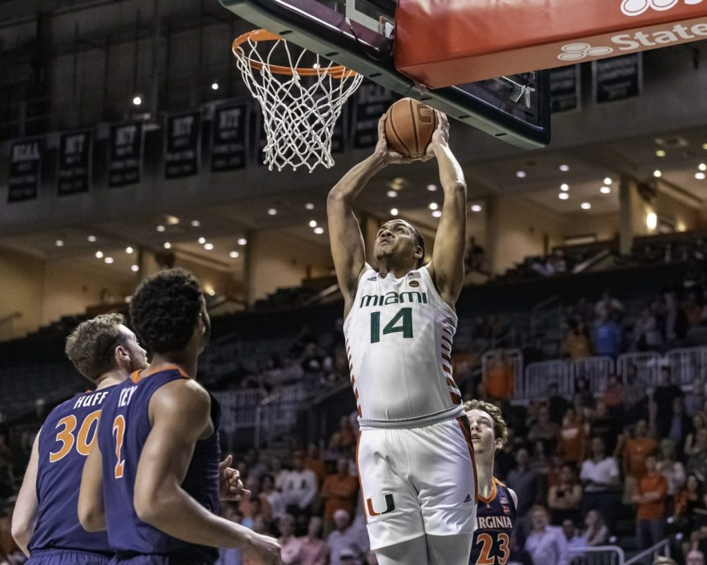 Redshirt junior center Rodney Miller attempts a dunk in Miami�a 46-44 loss to Virginia Wednesday, March 4. Miller had six points and grabbed 4 rebounds in the game.