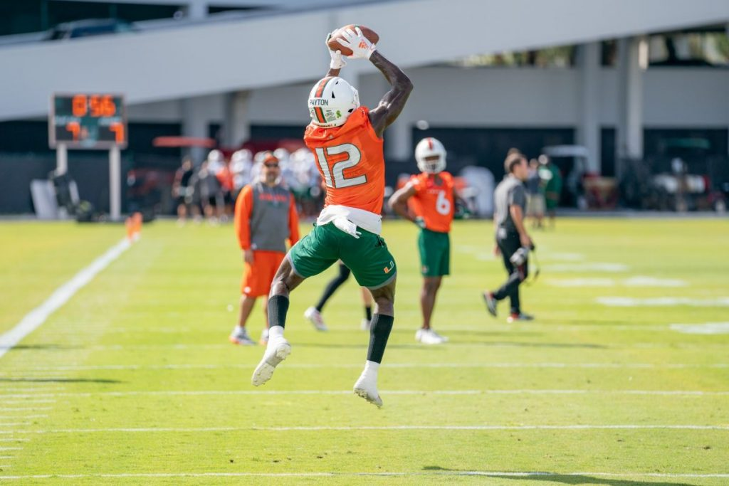 Redshirt Freshman wide receiver Jeremiah Payton leaps to catch the ball during the first day of Miami's spring training on Wednesday, March 2 at the Greentree Practice Facility.