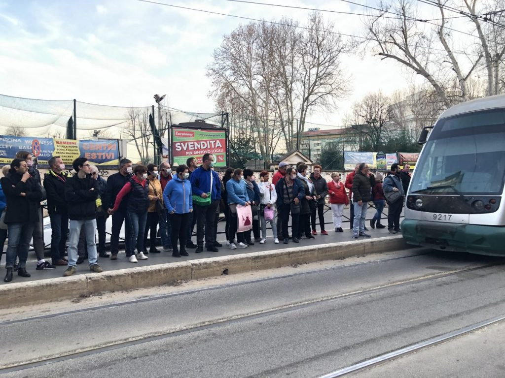 At the tram stop outside Grace Harrington's apartment in Rome, several people were wearing masks as a protective measure during the coronavirus outbreak in Italy on Feb. 25.