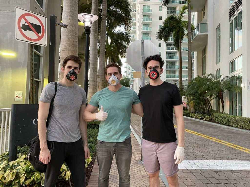 From left, Lance, Mitchell and Marc Levine make it back to their home base in Brickell after distributing another round of masks to the nearby homeless community on Sunday, May 4.