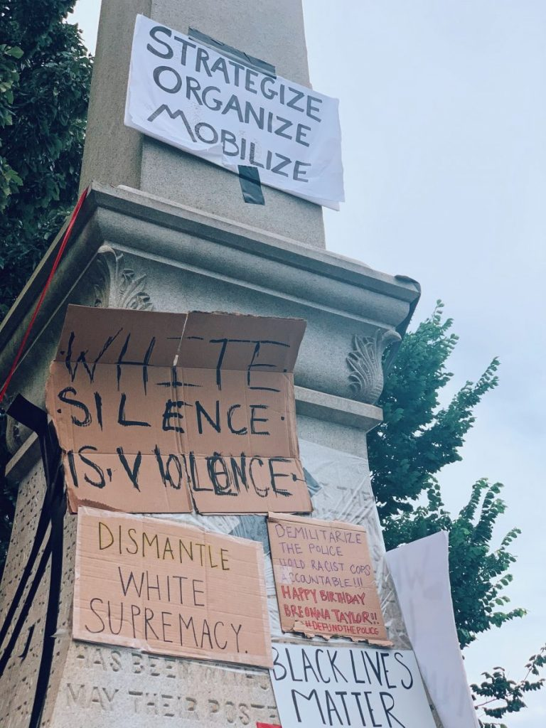 Signs calling for change adorn a Confederate monument during protests in Decatur, GA on Friday, June 5, 2020.