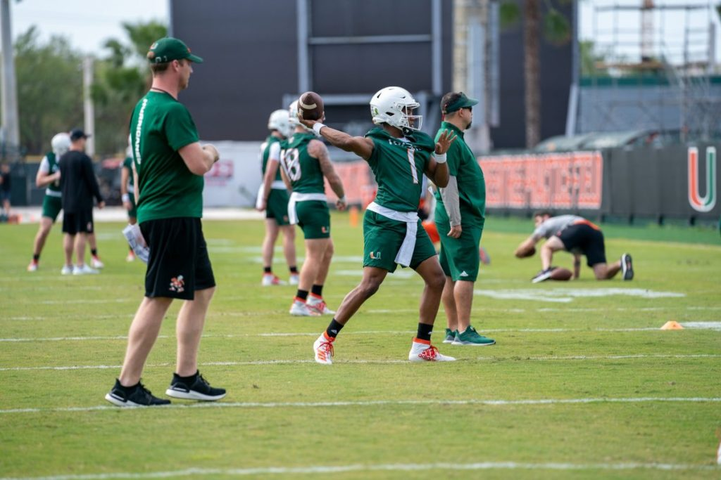Redshirt Senior quarterback D'Eriq King throws the ball during the second day of Miami's spring training as Offensive Coordinator Rhett Lashlee watches on March 3 at the Greentree Practice Facility.