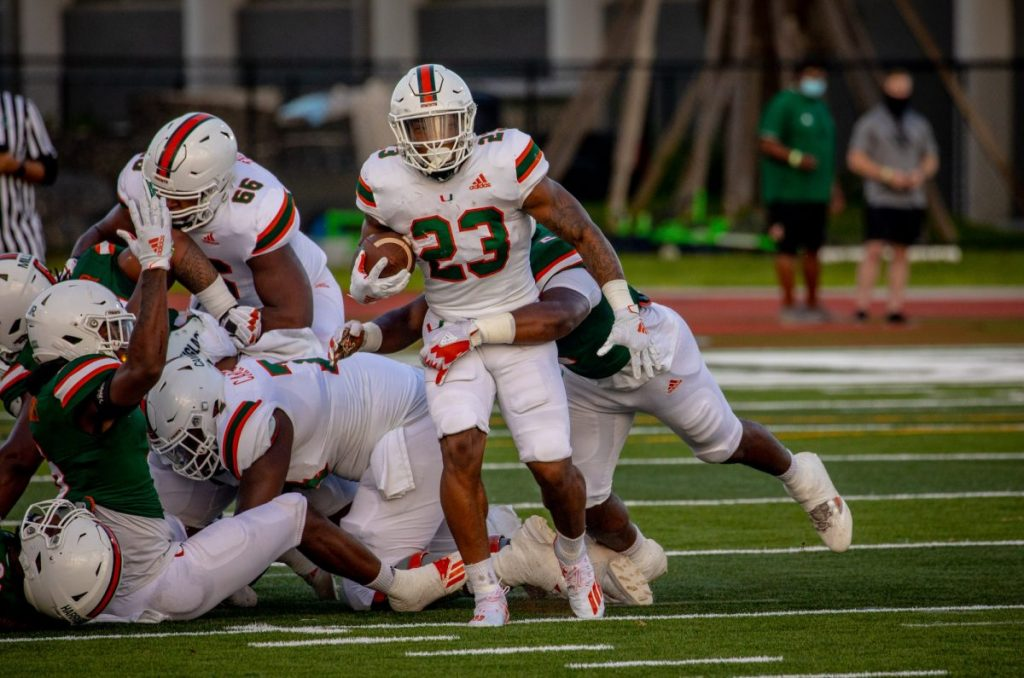 Running back Cam'Ron Harris (23) scored three touchdowns, one rushing and two receiving, during Miami's scrimmage on Saturday afternoon.
