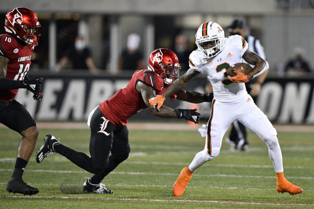 Wide Receiver Mike Harley (3) evades Louisville defensive back Russ Yeast (3) during the first half of play at Cardinal Stadium in Louisville, Ky. on Saturday, Sept 19.