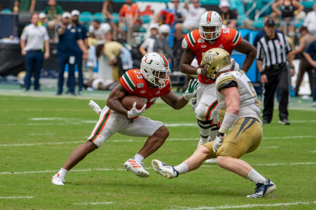Then-Sophomore Running Back Cam'Ron Harris attempts to juke a defender during Miami's game versus Georgia Tech at Hard Rock Stadium on Oct. 19, 2019.