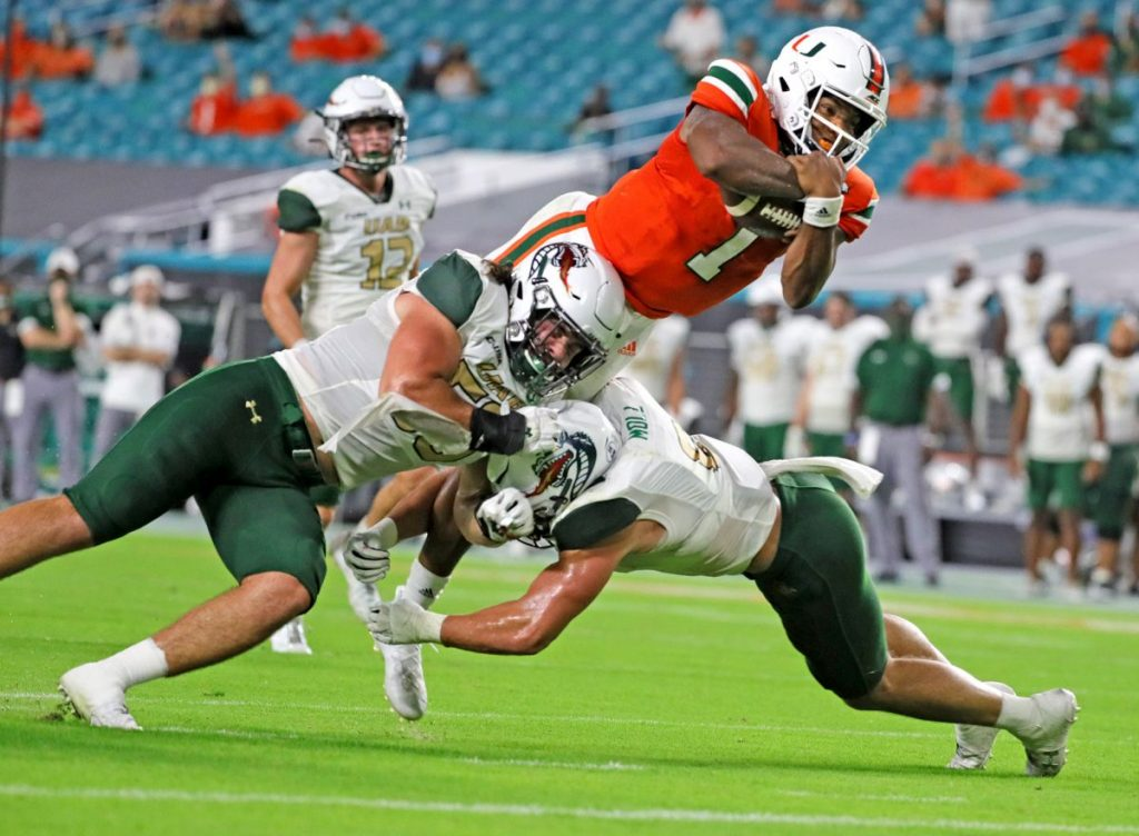 Senior quarterback D'Eriq King (1) leaps for a second-quarter touchdown as the University of Miami hosts the UAB Blazers at Hard Rock Stadium in Miami Gardens on Thursday, September 10, 2020.