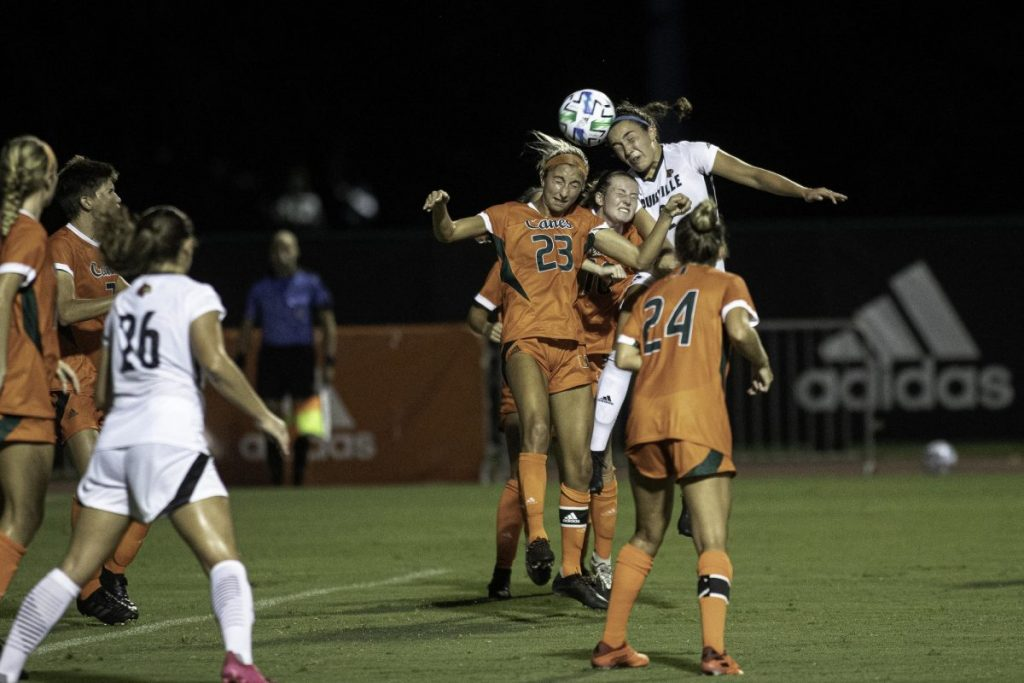 Senior Tia Dupont and freshman Julia Edwards jump to contest a header during Miami's 3-0 loss versus Louisville on Thursday, Sept. 17. Louisville held Miami to 0 shots on goal throughout the game.
