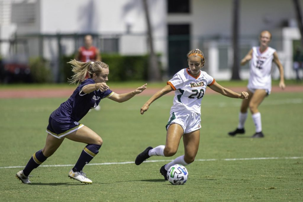 Freshman Michaela Baker fights to retain possession while bringing the ball up the field in Miami's 6-0 loss to Notre Dame at Cobb Stadium on Sunday, Sept. 20.