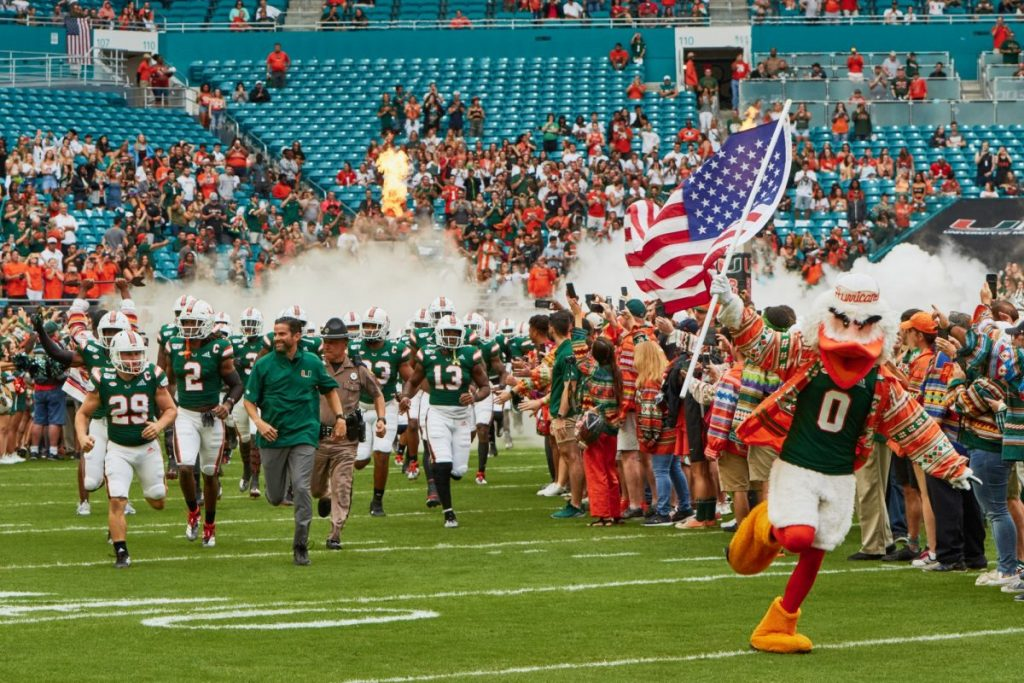 The Canes football team, led by Sebastian, charge through the smoke at Hard Rock Stadium before Miami's game versus Louisville on Nov. 9, 2019.