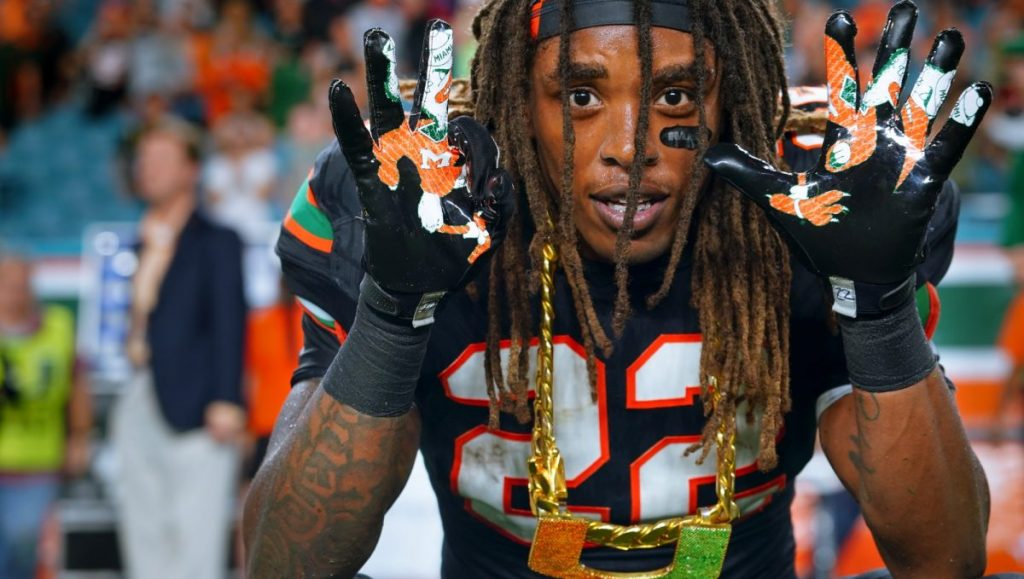 Former 'Cane, and current Cleveland Browns safety, Sheldrick Redwine throws up the 305 with while wearing the turnover chain during Miami's Homecoming game versus Virgnia Tech at Hard Rock Stadium on Nov. 4, 2017. Redwine had his first NFL interception on Tuesday night during the Browns game versus the Indianapolis Colts.