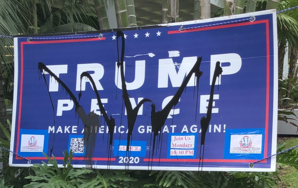 Black paint was thrown on one Trump sign by a student, near the Rock Plaza on Monday, Oct. 26. Photo credit unknown.