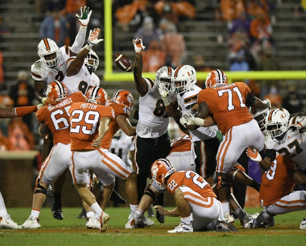 Miami blocks a 61-yard field goal attempt by Clemson kicker B.T. Potter (29) during Miami's game against Clemson at Memorial Stadium in Clemson, SC on Saturday, Oct. 10, 2020.