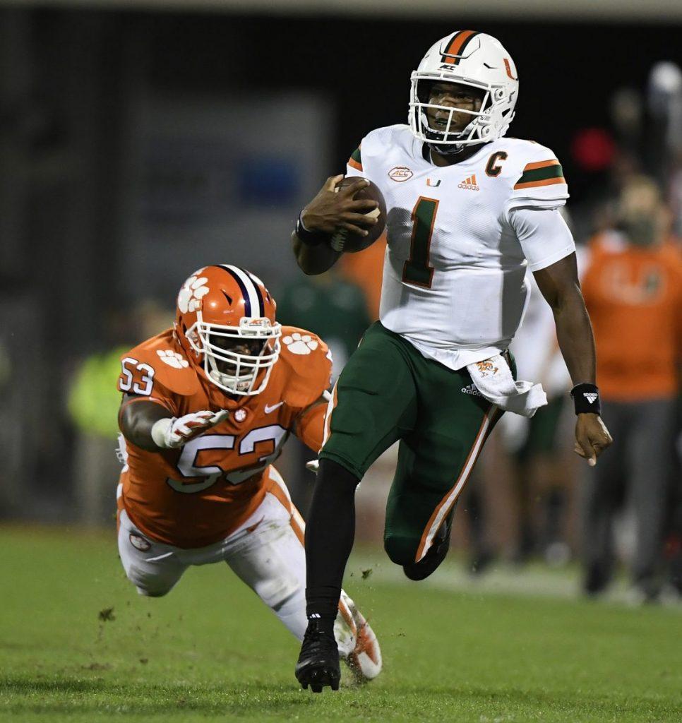 Quarterback D'Eriq King (1) carries past Clemson linebacker Regan Upshaw (53) for a big gain during the 2nd quarter during Miami's game versus Clemson at Memorial Stadium in Clemson, South Carolina on Saturday, Oct. 10.