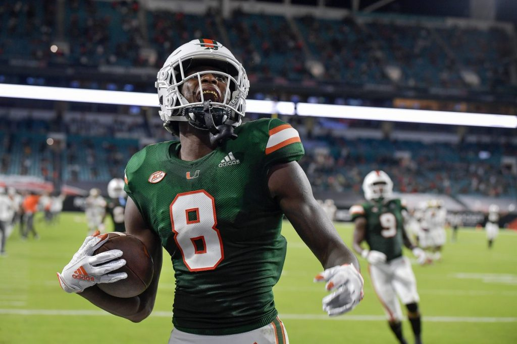 Wide Receiver Dee Wiggins (8) celebrates scoring a touchdown during the first half of Miami's game versus Florida State on Sept. 26.