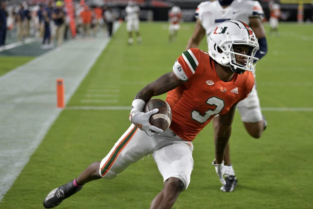 Receiver Mike Harley catches a touchdown pass in front of Virginia linebacker Noah Taylor during the first half of Miami's game versus Virginia at Hard Rock Stadium in Miami Gardens, Florida on Saturday, Oct. 24.