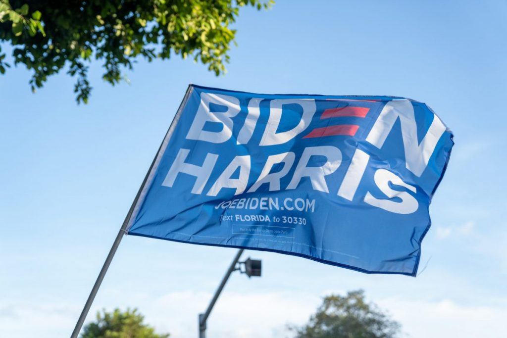 A Biden Harris sign flies at an intersection near the Coral Gables Library on Tuesday, Nov. 3.