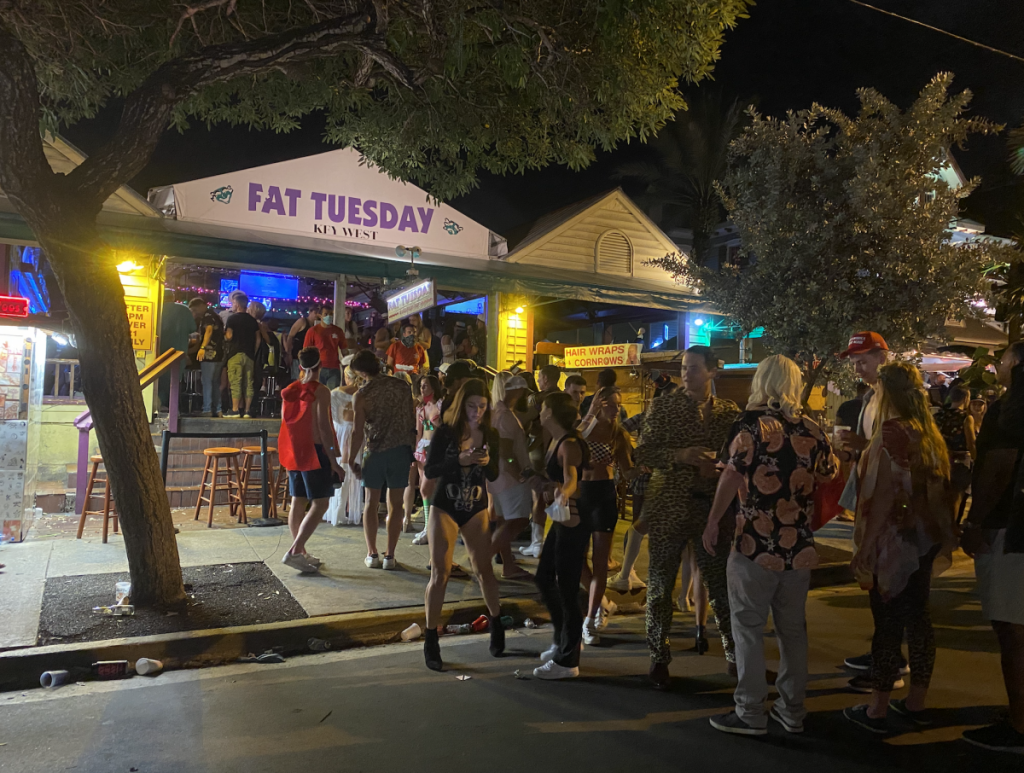 Large groups of maskless patrons filled the areas inside and out of Fat Tuesday on Duval Street in Key West on Saturday, Oct. 31.